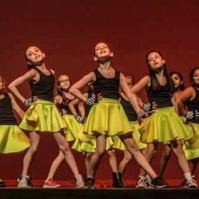 Junior hip hop students perform on stage at the semi-annual Gala