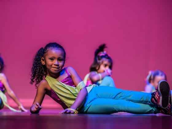 Tots students perform on stage at the semi-annual Gala
